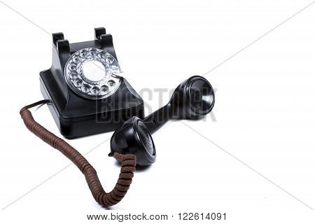 A Black Rotary Phone With The Reciver Off The Hook
