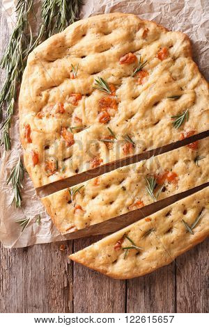 Sliced Italian Focaccia With Rosemary And Cheese Close-up. Vertical Top View