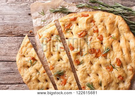 Sliced Italian Focaccia With Rosemary And Cheese Close-up. Horizontal Top View