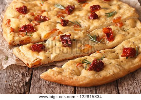 Tasty Italian Focaccia With Dried Tomatoes Close Up On The Table. Horizontal