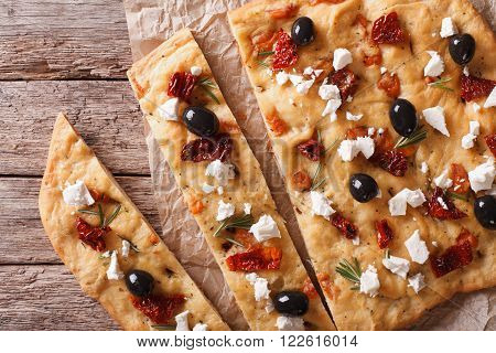 Focaccia With Dried Tomatoes, Feta And Olives Closeup. Horizontal Top View