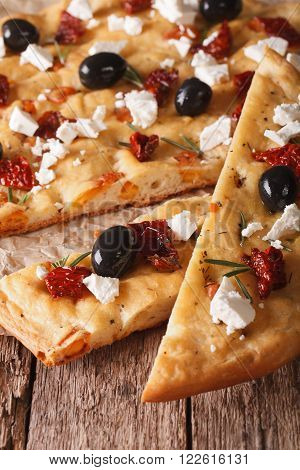 Focaccia With Dried Tomatoes, Feta And Olives. Macro Vertical