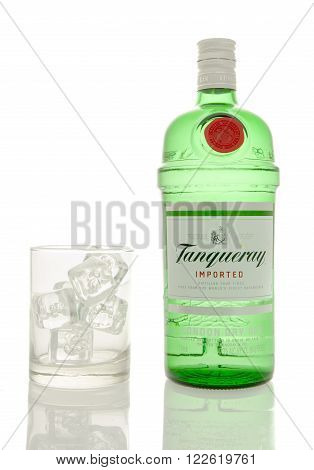 Winneconne WI - 10 March 2016: A bottle of Tanqueray gin with a empty glass of ice.