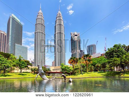 KUALA LUMPUR MALAYSIA - Ferbruary 5: Petronas Towers on February 5 2016 in Kuala Lumpur Malaysia.Petronas Towers is the tallest buildings in the world from 1998 to 2004