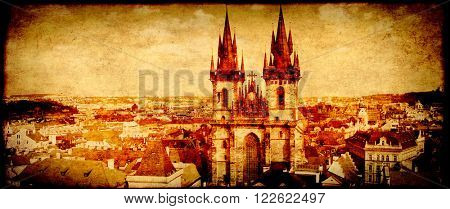 Grunge background with paper texture and landmark of Czech Republic - Tyn Church on Old Town Square in Prague