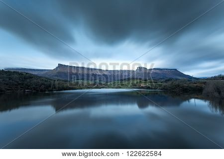 Clouds in movement reflected in a beautiful lake