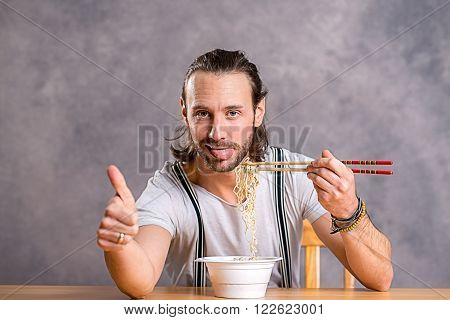 Funny Young Man Eating Asian Food