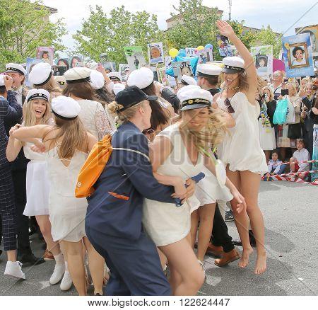 STOCKHOLM SWEDEN - JUN 10 2015: Group of happy teenages wearing graduation caps celebrating the graduation after finishing high school at the school Globala gymnasiet June 10 2015 Stockholm Sweden