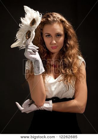 Beautiful Woman In Dress Holding A Mask
