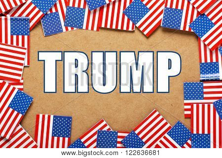 The name of United States Presidential candidate for the Republican party, Trump surrounded by a border of American flags
