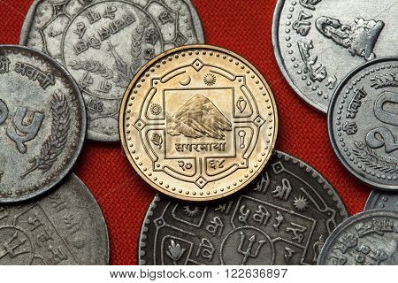 Coins of Nepal. Mount Everest (Sagarmatha) depicted in the Nepalese one rupee coin.