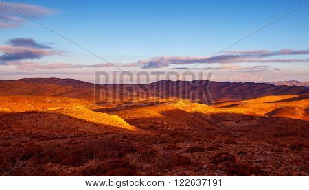 Beautiful mountains landscape, golden dry grass on the hills, amazing view on Lebanese countryside in sunny day
