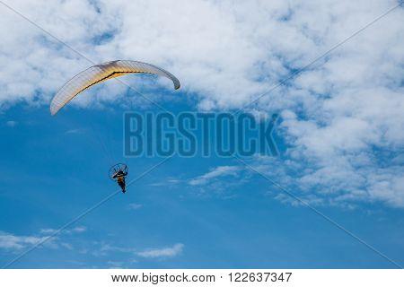 Speedflyer paragliding in blue sky- copy space