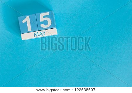 May 15th. Image of may 15 wooden color calendar on blue background.  Spring day, empty space for text. World Remembrance Day of AIDS Victims.