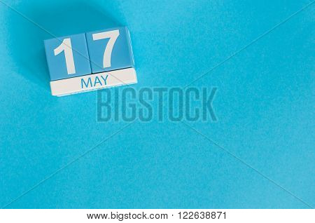 May 17th. Image of may 17 wooden color calendar on blue background.  Spring day, empty space for text.  International Day Against Homophobia, IDAHOBIT.