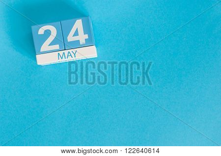 May 24th. Image of may 24 wooden color calendar on blue background.  Spring day, empty space for text. The European Day of Parks, EDoP.