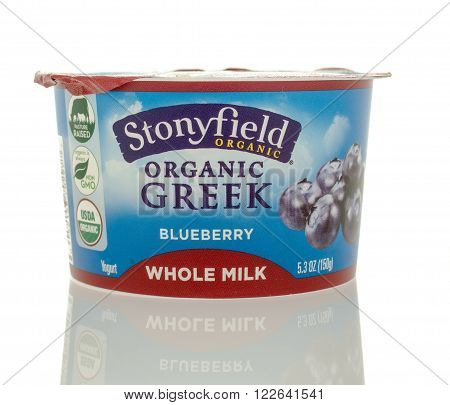 Winneconne WI - 5 March 2016: A container of Stonyfield organic greek yogurt in blueberry flavor.