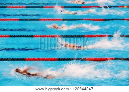 Freestyle swimming race, motion blurred image.