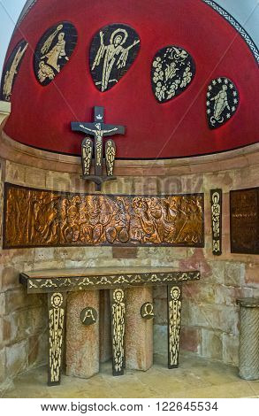 JERUSALEM, ISRAEL - FEBRUARY 16, 2016:  The scenic altar in crypt of the  Dormition Church was donated by Ivory Coast, on February 16 in Jerusalem.