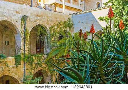 JERUSALEM, ISRAEL - FEBRUARY 16, 2016: The tropic garden in the courtyard of Lutheran Kirche of the Redeemer, on February 16 in Jerusalem.