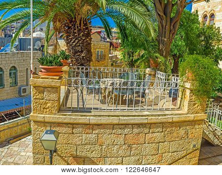 The old mansion boasts such small terraces for the watching the city life Jerusalem Israel.