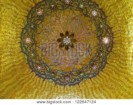 JERUSALEM ISRAEL - FEBRUARY 16 2016: The cupola in the Church of the Flagellation decorated with mosaic crown of thorns on the golden background on February 16 in Jerusalem.