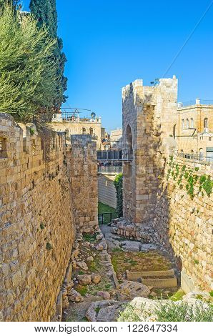 The deep moat of the King David's citadel with the small bridge connecting it with the gate Jerusalem Israel.