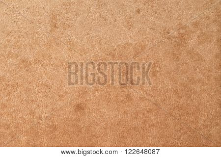 Obsolete stained brown leather texture as background