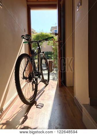 Bicycle indoor home at open door entrance street view