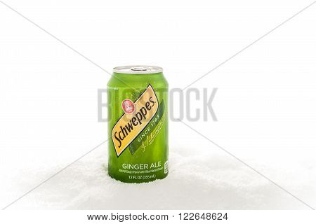 Winneconnie Wisconsin - 31 January 2015: Can of Schweppes Ginger Ale in the snow. Schweppes is owned by teh Dr Pepper Snapple Group.