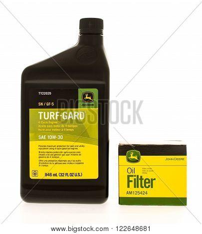 Winneconne WI - 7 July 2015: Bottle of Turf-Gard oil and oil filter made for John Deere equipment.