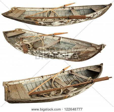The old boat with oars and a rope inside. Isolated on a white background.