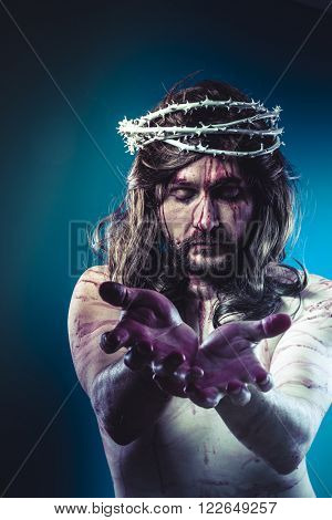 Easter jesus christ, son of god representation with crown of thorns and wounds of Calvary skin