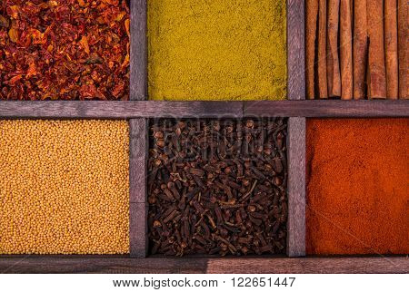 Carnation and spices in a wooden box