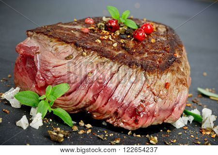 medium rare grilled steak with spices close up