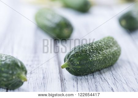 Small green Gherkins (detailed close-up shot) on wooden background ** Note: Shallow depth of field