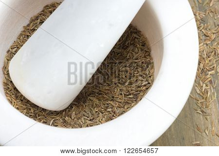 Zira or cumin - seeds in a marble mortar for spices