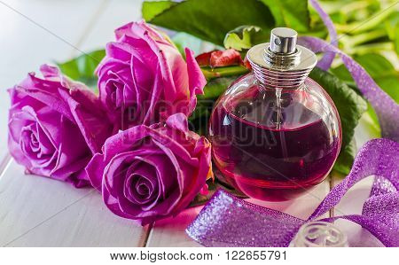 perfume in a bottle of the scent of roses