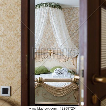Half opened door of a bedroom, opening door closeup.