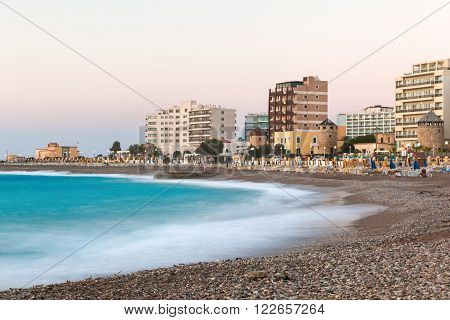 Greece, Rhodes - July 16 : Urban beach in the evening on July 16, 2014 in Rhodes, Greece