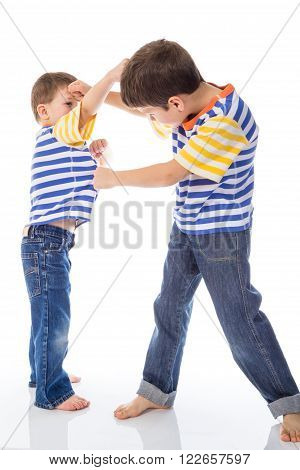 Two small boys fighting isolated in white