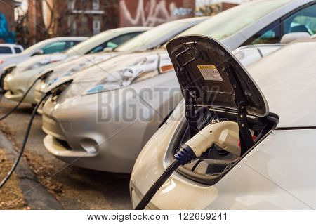 Montreal CA March 21th 2016. Electric cars charging at recharging station.