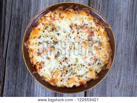 pasta cheese gratin on wooden table high angle view