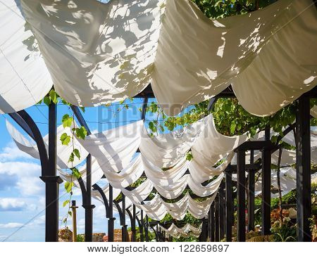 White cloth canopy from the sun in a recreation area outdoor.