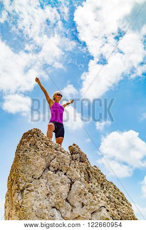 Success achievement running or hiking accomplishment business concept woman celebrating with arms up raised. Hands outstretched on trekking or climbing trip. Trail Running concept outdoors in inspirational landscape.