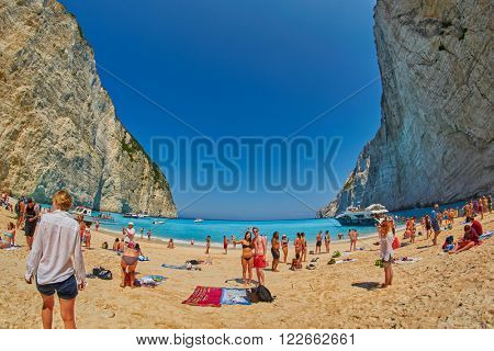 ZANTE ISLAND, GREECE - CIRCA JUNE 2015: Tourists taking selfie shots and enjoying Navagio Bay with Pirate's Shipwreck