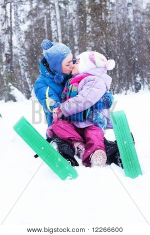 Happy Mother And Daughter, The Family For A Walk In A Winter Park, Luge, Skiing, Skating, Snowballs