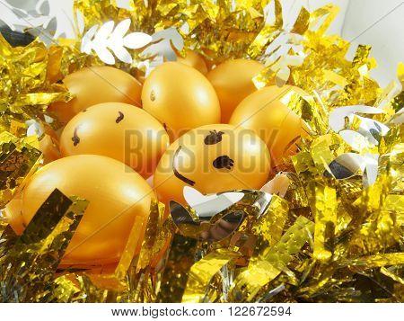 Group of easter eggs on golden tuft, happy easter day festival