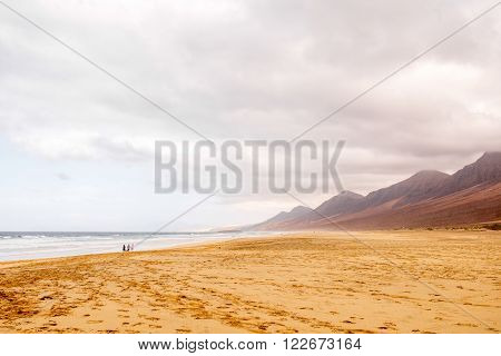 Cofete beach at the cloudy and foggy weather on Fuerteventura island in Spain