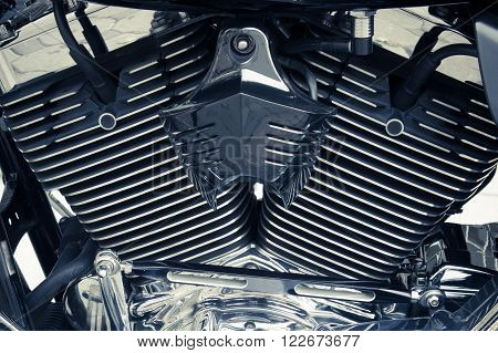 Motorbike's chromed and internal combustion engine background